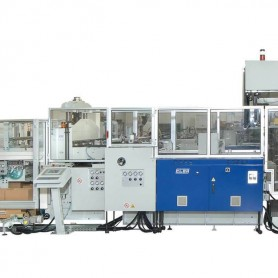 Machine with lateral packing unit